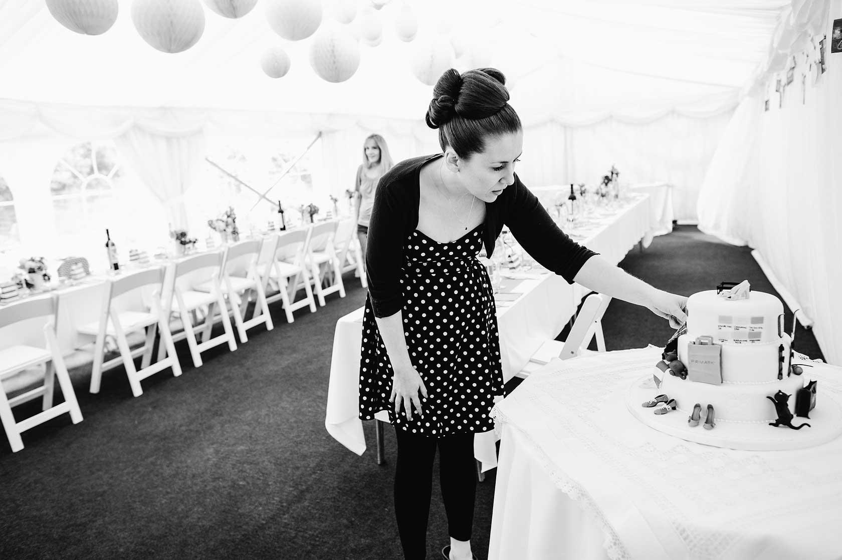A bride checks her three tiered cake