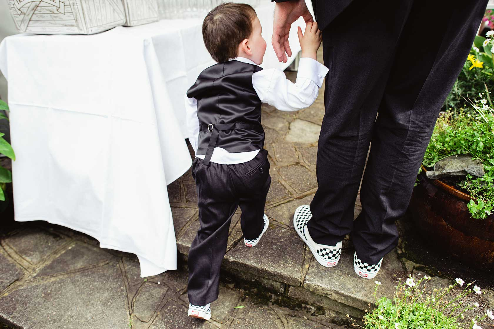Groom in chequered Vans shoes