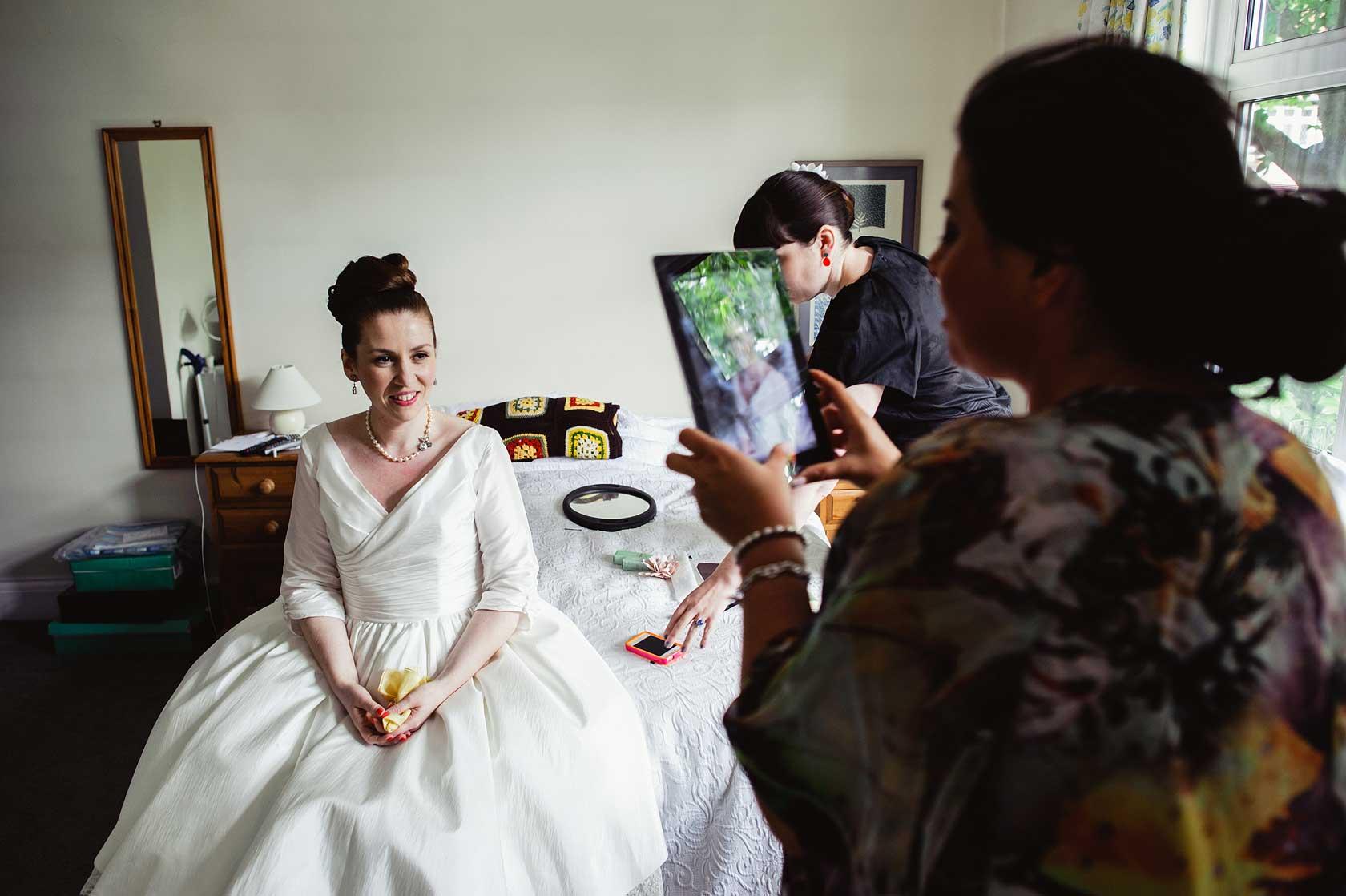 A make-up artist taking a photograph