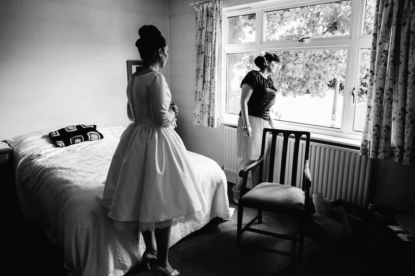 A bride and her sister await the grooms srrival
