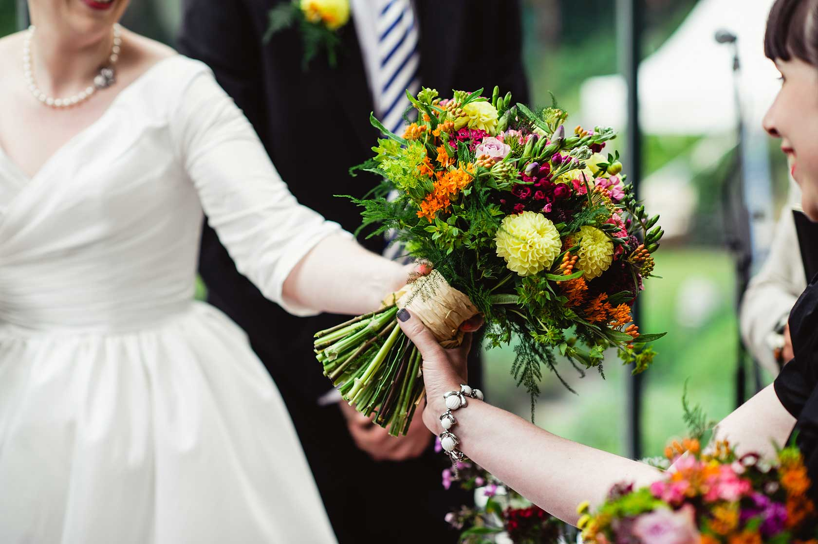 Bridal bouquet is passed to the bride's sister