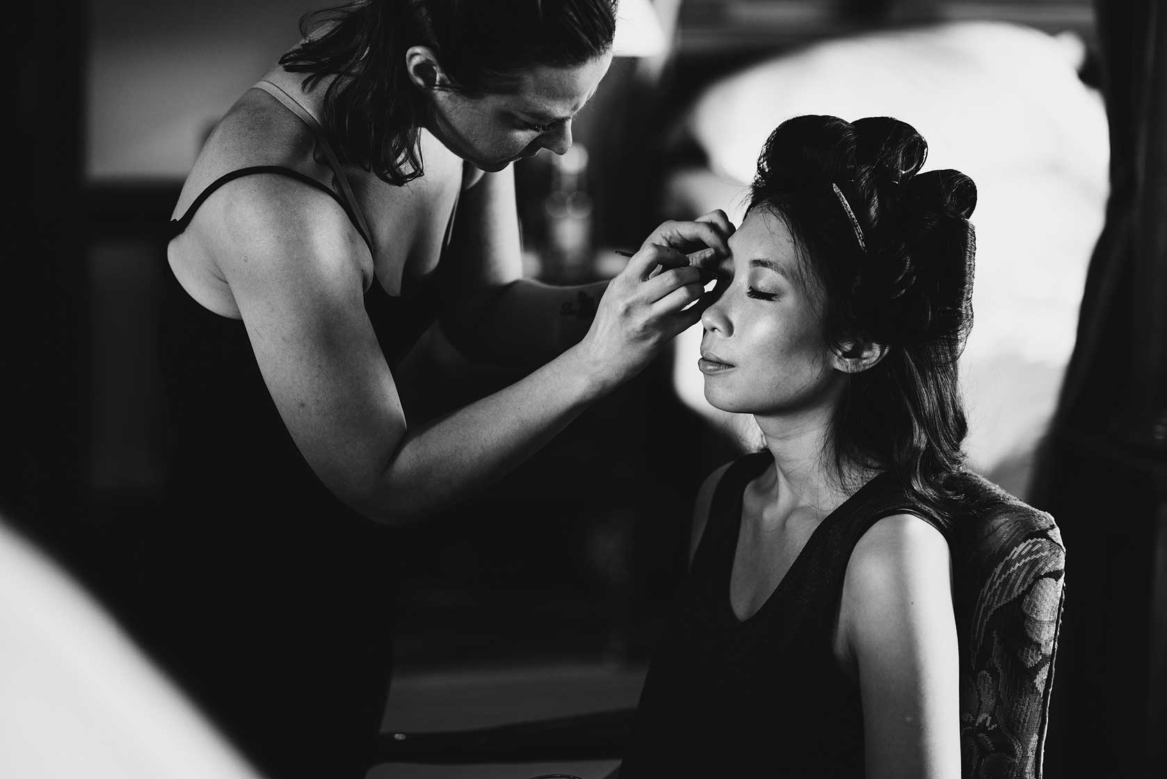 A make-up artist prepares the bride