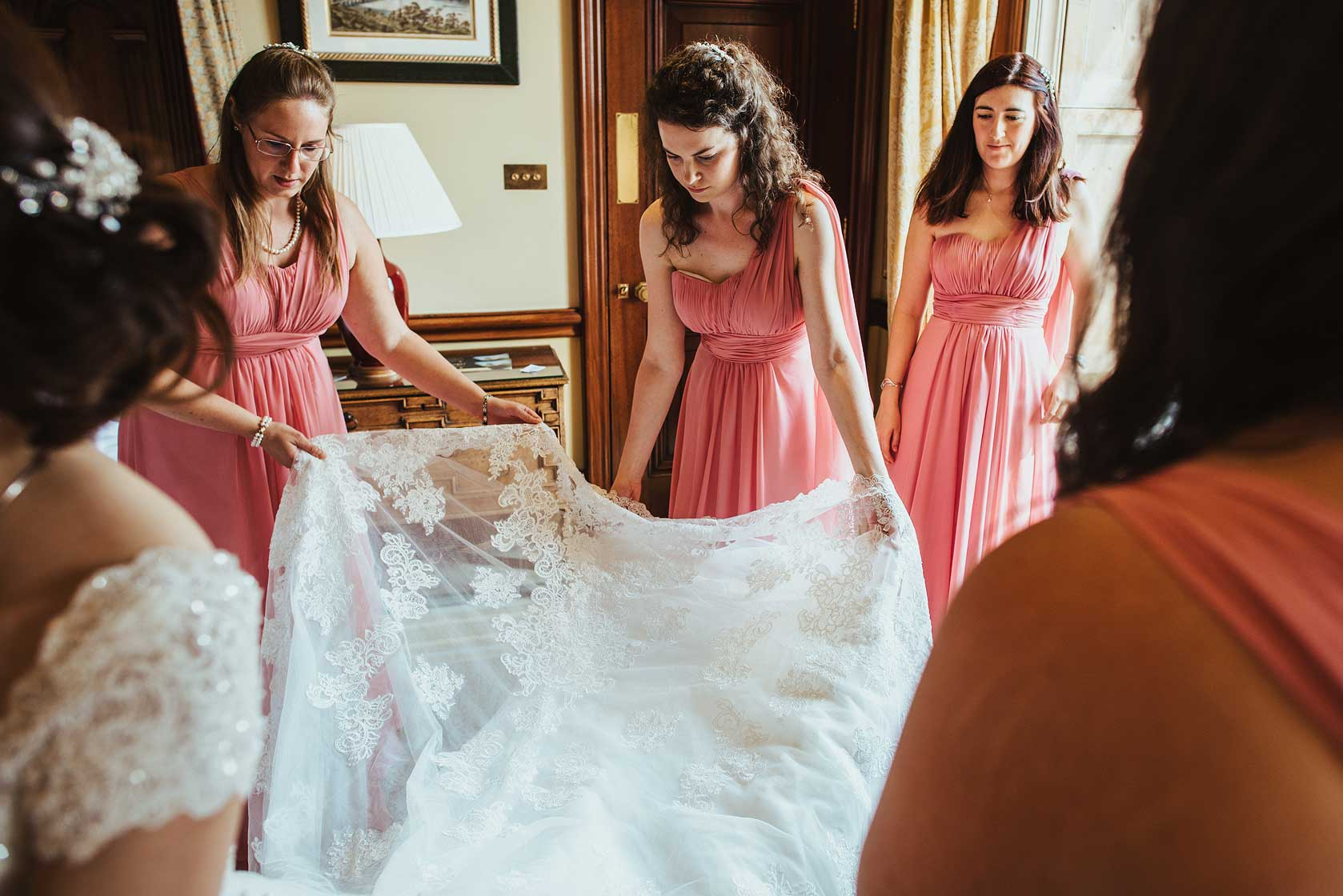 Bridesmaids checking the wedding dress at Buckinghamshire wedding