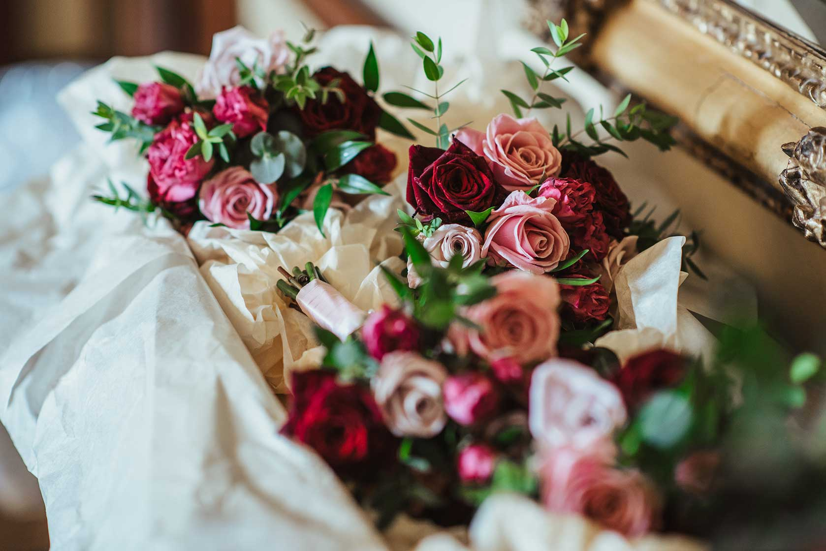 Pink and red roses in wedding bouquets at Stoke Park