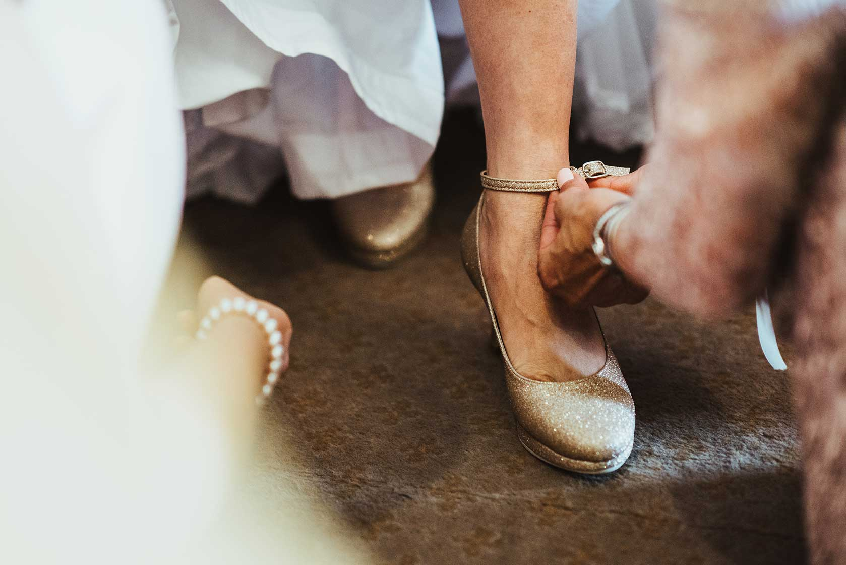 Wedding shoes fitted by bridesmaids at Stoke Park